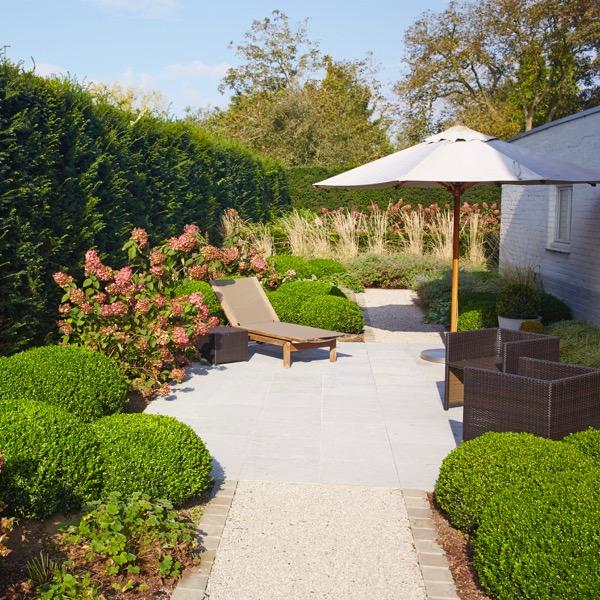 Charmante tuin met warme plantenborders / Sint-Martens-Latem